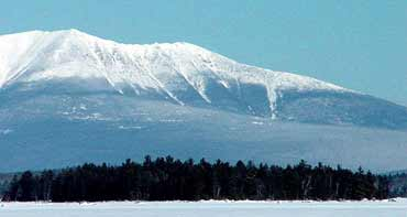 Snow covered lake and Mt. Katahdin view from every room