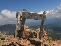 Sign at Pamola Peak with Traveler Mountain in background