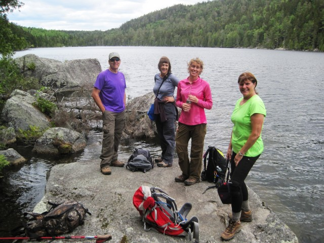 Hikers taking a break on the south shore of Horserace Pond